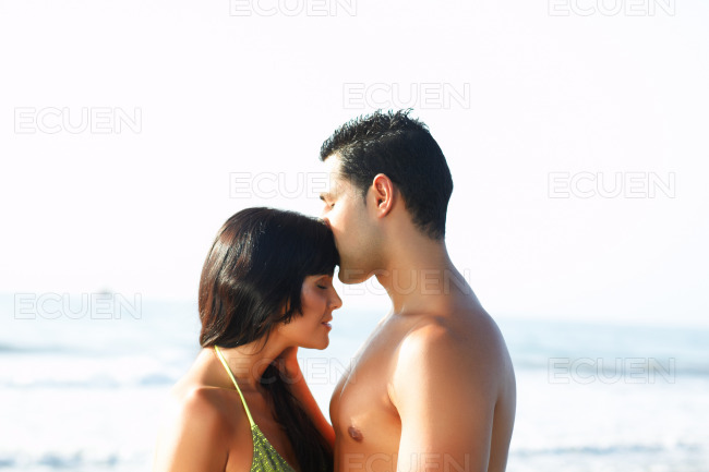 Loving couple on the edge of the beach stock photo