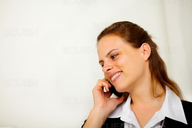 Natural young businesswoman at cell phone stock photo