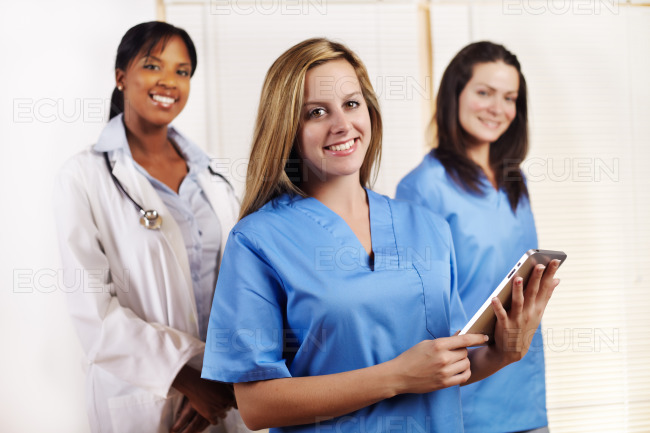 Nurse standing in front of his team stock photo