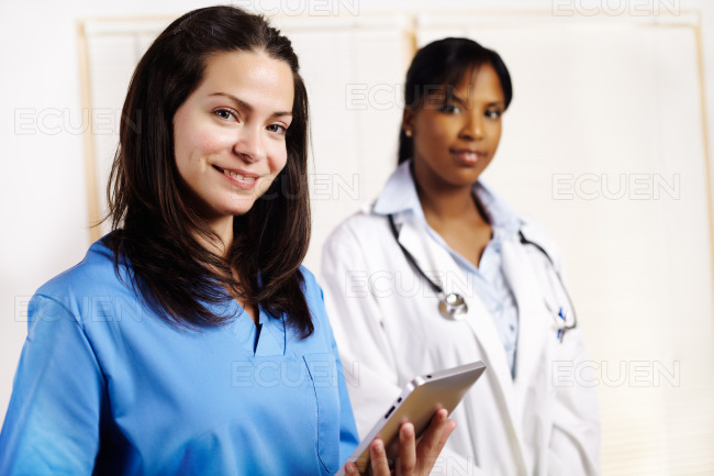 Nurse with a co-workers stock photo