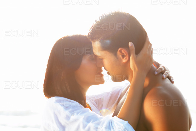 Passionate couple in love kissing and embracing between backli stock photo