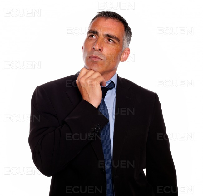 Peaceful and reflective man touching the chin stock photo