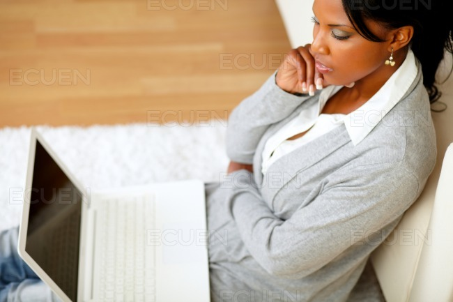 Pensive attractive woman sitting on the floor stock photo
