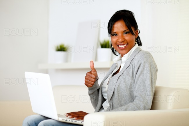 Positive afro-american woman looking to you stock photo