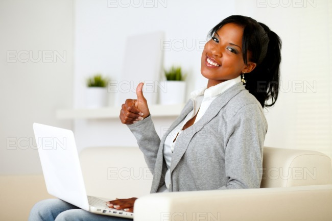 Positive afro-american young woman looking to you stock photo