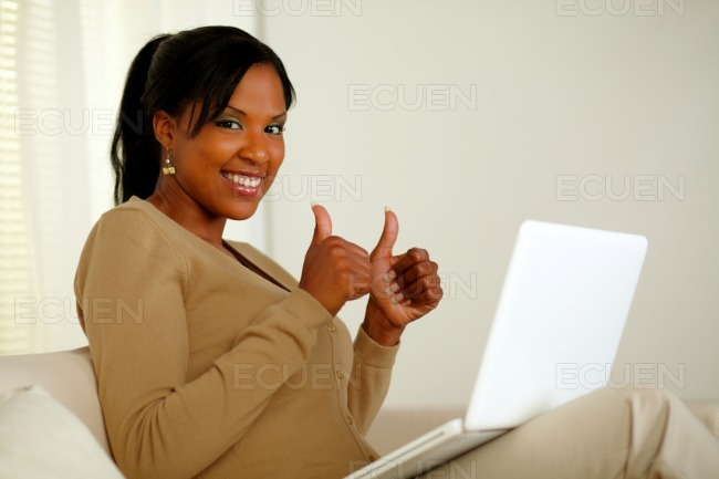 Positive pretty afro-american woman looking at you stock photo