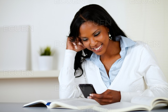 Prettty lovely woman smiling with cellphone stock photo