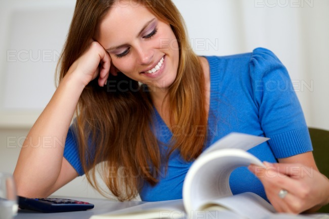 Pretty blonde student woman smiling and learning stock photo