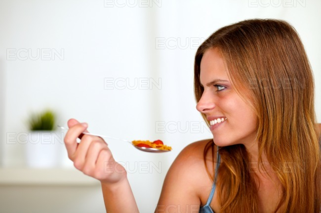 Pretty blonde woman eating healthy food stock photo
