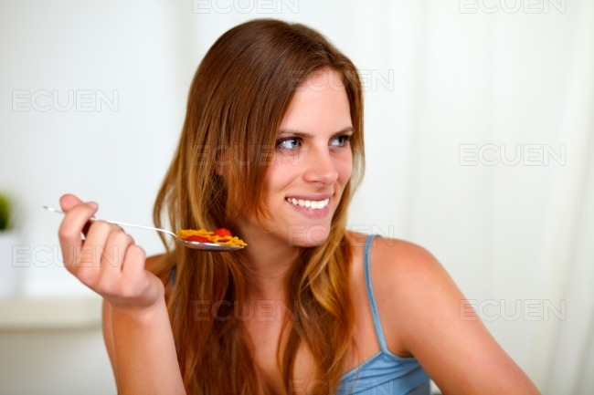 Pretty blonde woman eating healthy meal stock photo