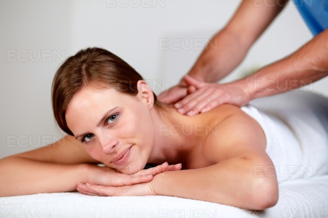 Pretty blonde woman relaxing at a spa stock photo