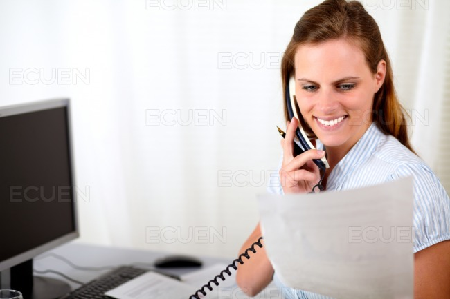 Pretty blonde woman working at the office stock photo