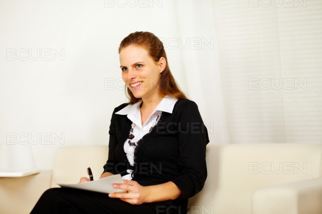 Pretty business woman working at home stock photo