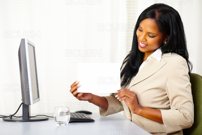 Pretty executive female showing a white card stock photo