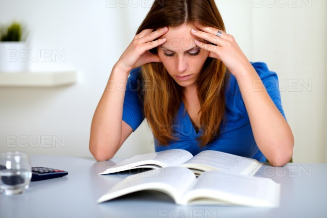 Pretty fatigue blonde student girl learning stock photo