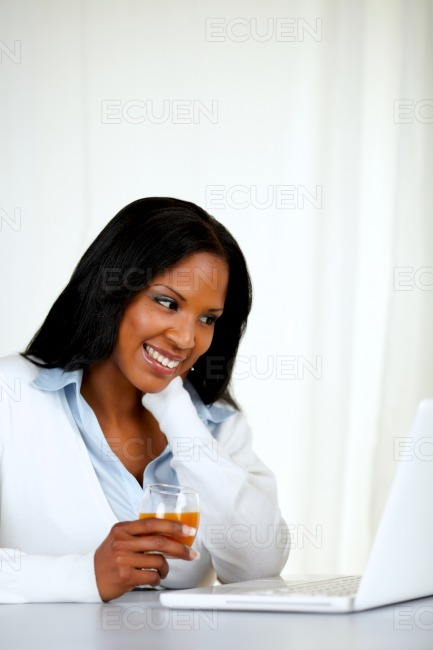 Pretty female smiling and reading stock photo