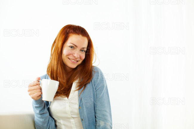 Pretty girl enjoying a caffee cup stock photo