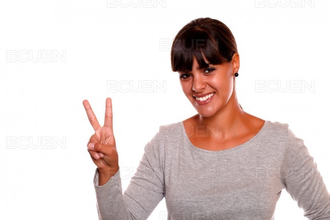 Pretty girl holding up two fingers in victory sign