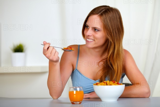 Pretty lovely woman smiling and eating stock photo