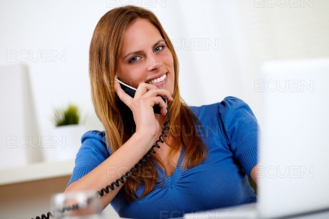 Pretty lovely woman smiling on phone stock photo