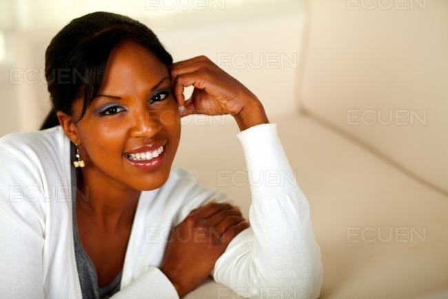 Pretty relaxed woman smiling and looking at you stock photo
