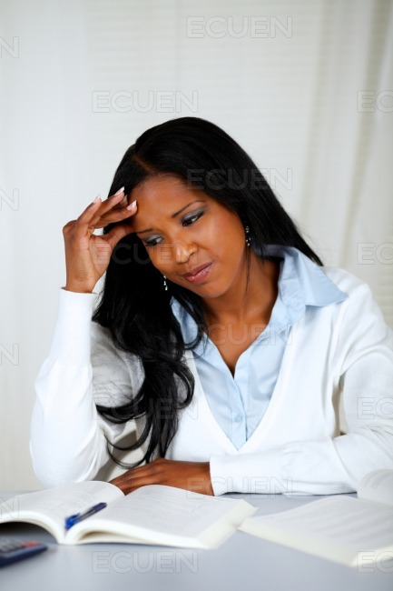 Pretty tired young black female learning stock photo