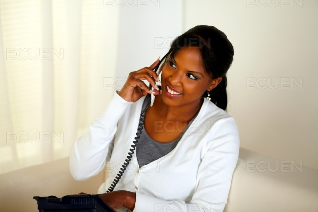 Pretty woman conversing on phone stock photo