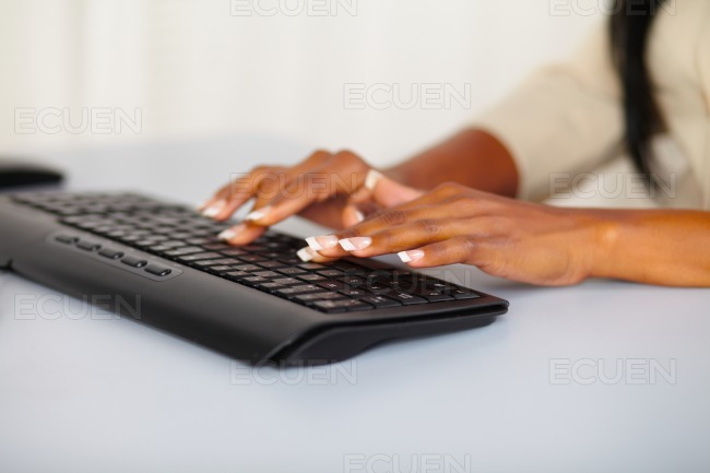 Pretty woman hands working on computer stock photo