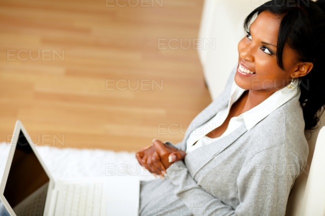 Pretty woman sitting at home on the floor stock photo