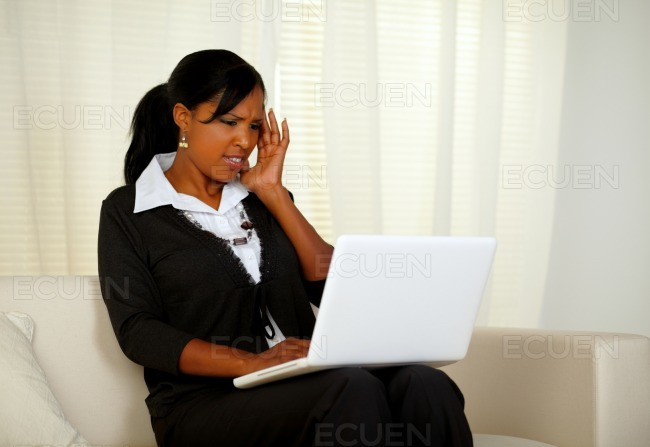 Pretty woman with headache working up to the limit stock photo