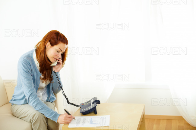 Pretty woman working and talking at phone stock photo