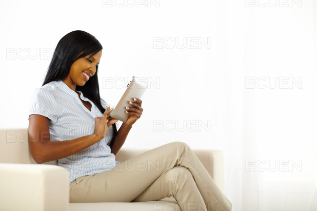 Pretty young lady using a tablet PC stock photo