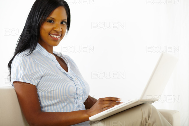 Pretty young woman working on laptop stock photo
