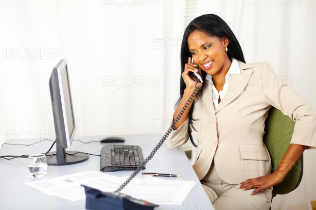 Professional female on phone stock photo