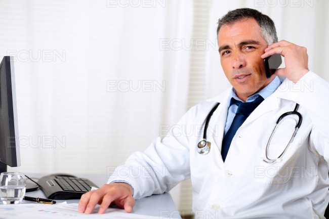 Professional friendly senior doctor stock photo