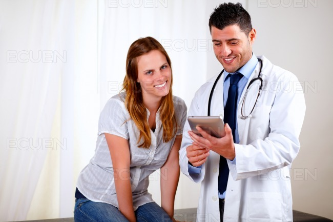 Professional medical doctor with a patient stock photo