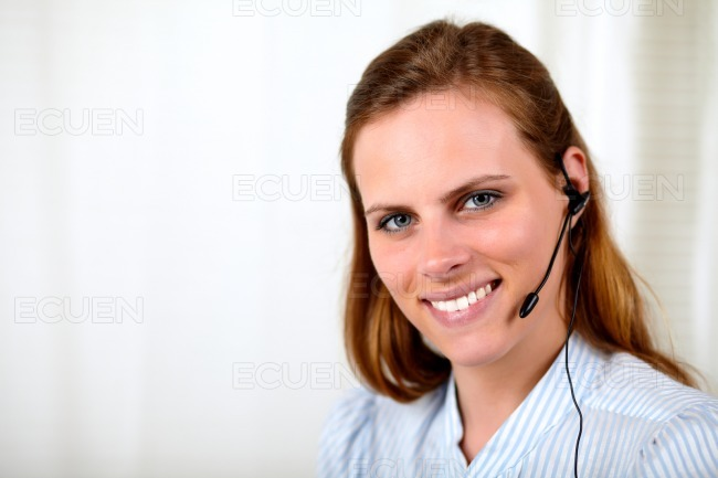 Professional receptionist smiling with earphone stock photo