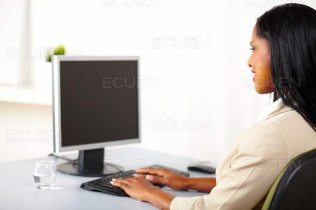 Professional woman looking to a monitor stock photo