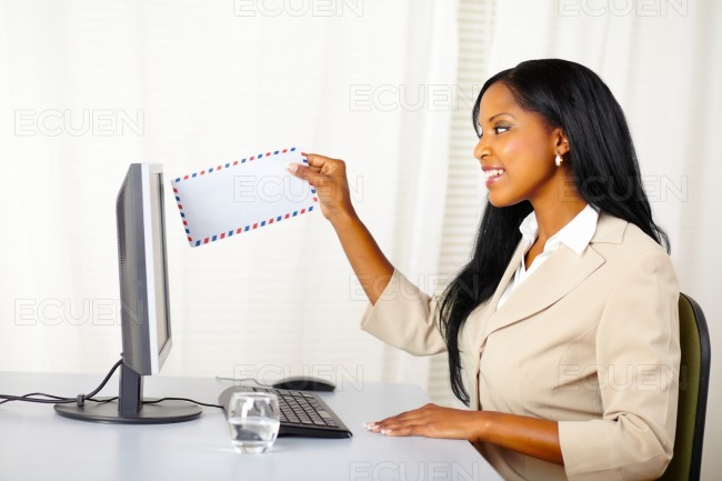 Professional woman sending a e-mail stock photo