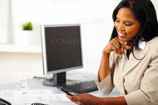 Professional woman using a mobile phone stock photo