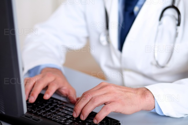 Professionals doctor hands working on computer stock photo