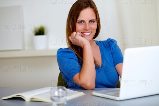 Reflective beautiful student girl smiling stock photo