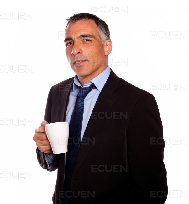 Reflective charming man with a white mug stock photo
