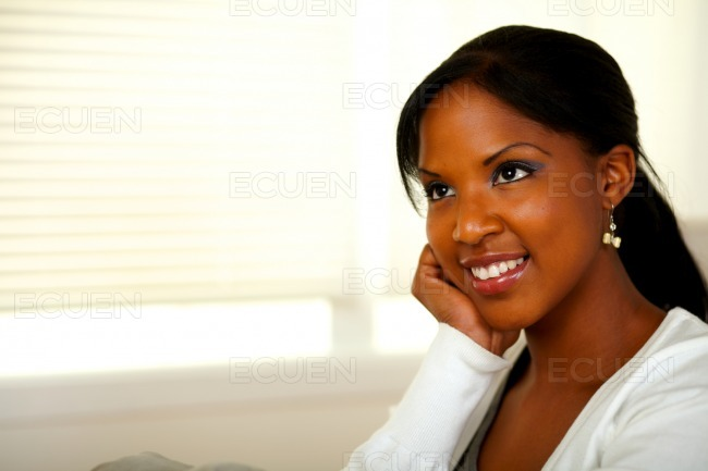 Relaxed afro-american young female smiling stock photo