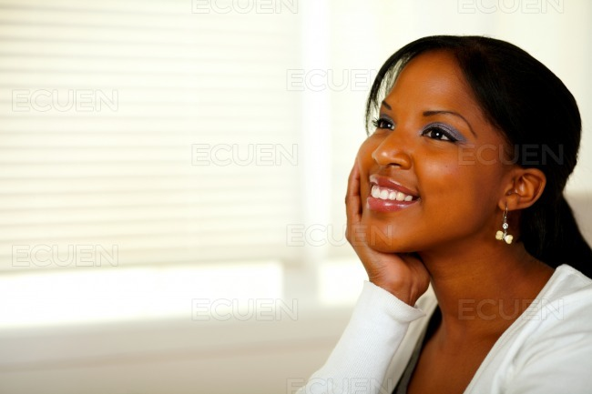 Relaxed afro-american young woman smiling stock photo