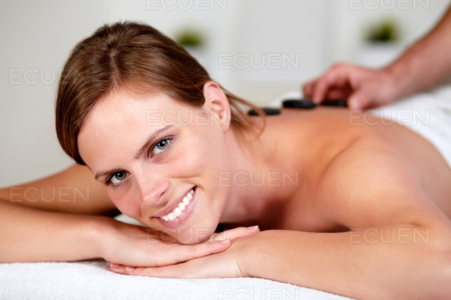 Relaxed girl receiving a massage at spa stock photo