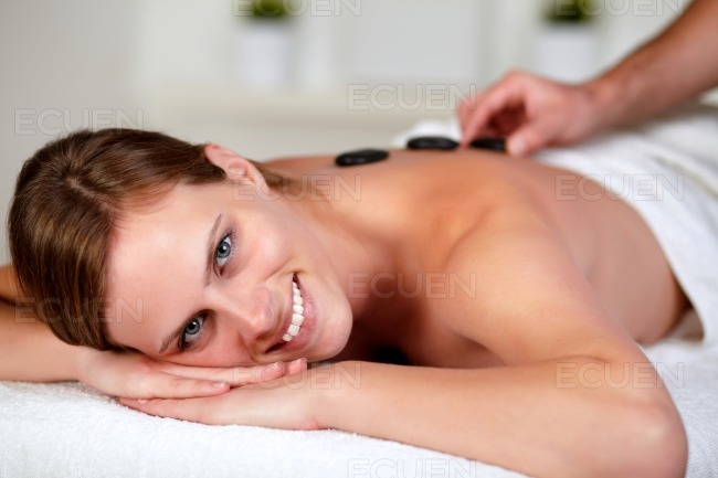 Relaxed woman receiving a massage at spa stock photo