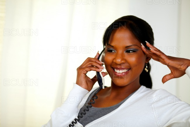 Relaxed woman smiling and talking on phone stock photo