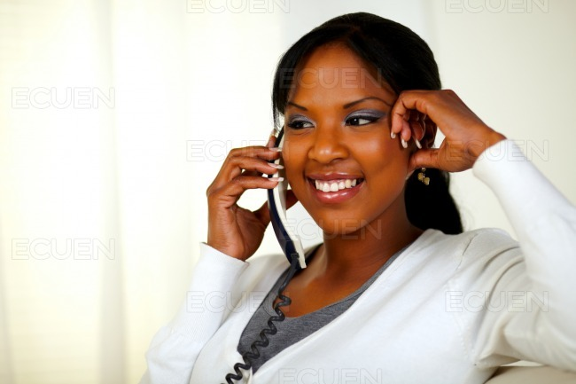 Relaxed woman speaking on phone stock photo