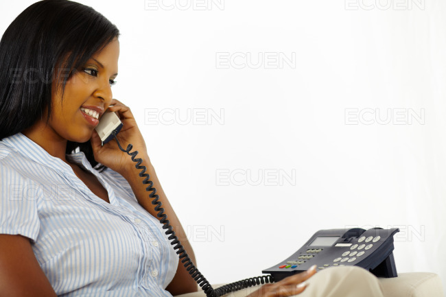 Relaxed young lady enjoying conversation on phone stock photo
